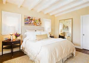 Warm paint colors for in bedroom traditional with exposed beams butter