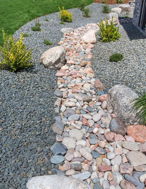 dry stream beds for drainage how to build a dry creek bed in the landscape