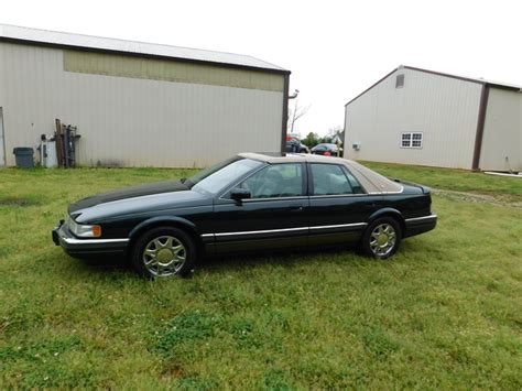 photos and videos 1997 cadillac seville sedan history in pictures kelley blue book 1997 cadillac seville overview cargurus