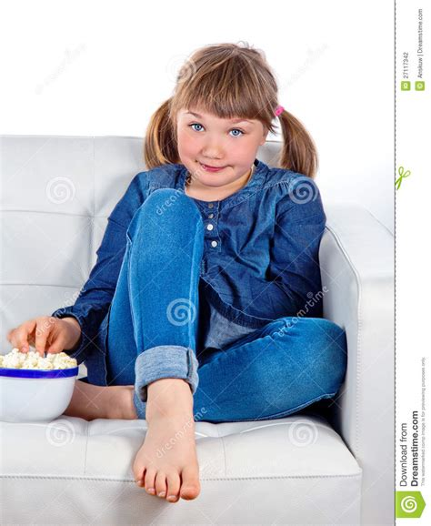 girl sitting on couch pretty little girl sitting on a couch stock photography