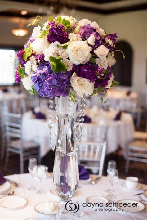 White, cream, deep purple. Roses, stock, hydrangea