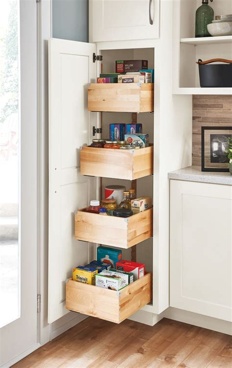 Kitchen Cupboard Storage Solutions - a pantry with drawers makes achieving a well