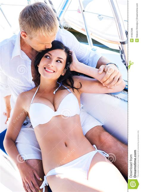women on boats young man and a woman relaxing on a boat stock photo