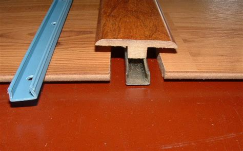 how to end laminate flooring at doorways installing laminate hallways from another room