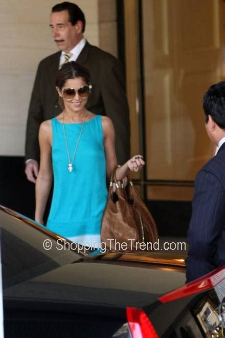 where does cheryl burton buy her clothes cheryl cole in la buy her turquoise white dress and