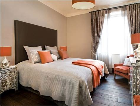 grey and brown bedroom decorating with orange centsational