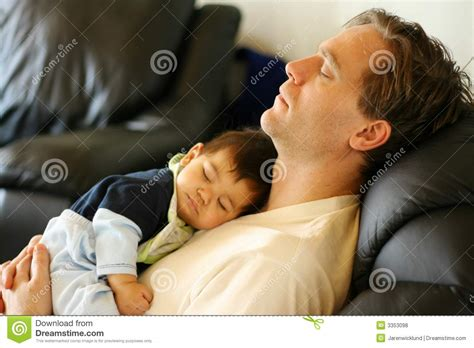 sleeping with baby in recliner father son sleeping focus dad royalty free stock photos