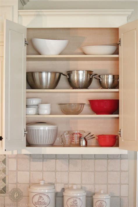 organizing racks for kitchen cabinets organizing your kitchen cabinets domestic charm