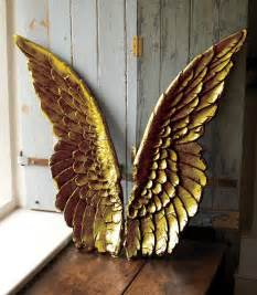 large gold wings wall by parlane at maison white