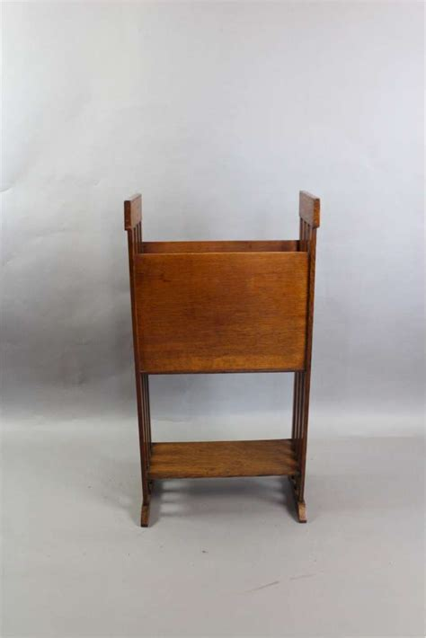 warehouse of table ls arts and crafts oak and leather magazine rack