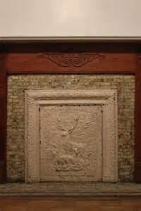 fireplace covers a pink brownstone in