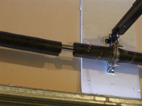 4 Signs Pointing Towards Garage Door Spring Replacement In Garage Door Broken