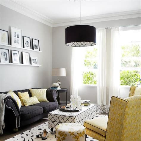 black and yellow living room yellow and black living room with black and white trellis ottoman contemporary living room