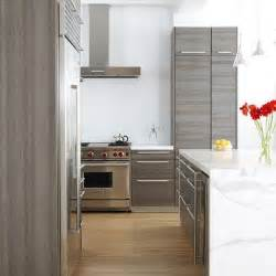 Custom companies can do this as well gray oak cabinets w light