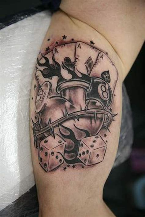 n tattoo photo barbed wire heart n dice tattoo on muscles tattoos book