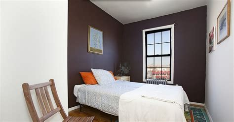 black painted walls bedroom the black painted walls in this bedroom bring the drama
