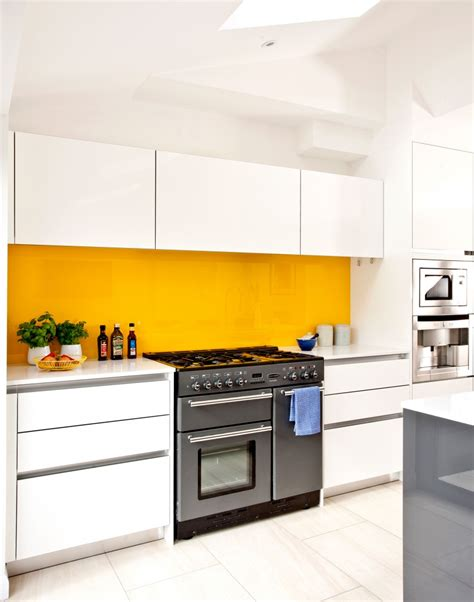 yellow and white kitchen ideas white modern kitchen with yellow splashback yellow