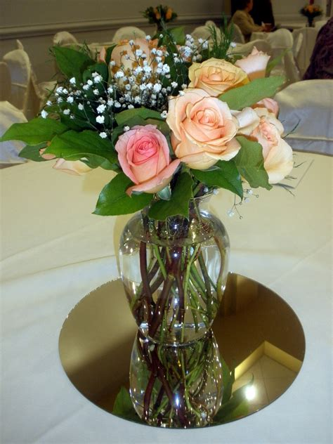 wedding centerpieces  fresh peach roses  greens raji creations
