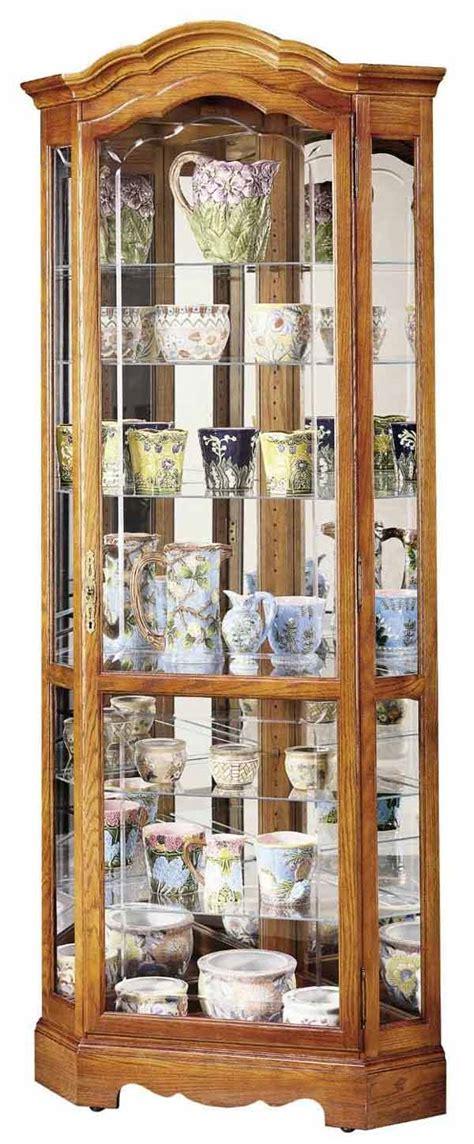 howard miller corner curio cabinet howard miller jamestown ii 680 250 oak corner curio cabinet