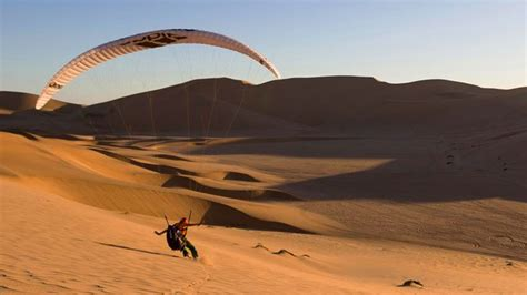 Sea Of Sand paragliding a sea of sand dunes in namibia