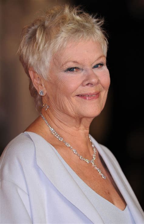 Dame Judi Dench sports 007 tattoo at the premiere of the