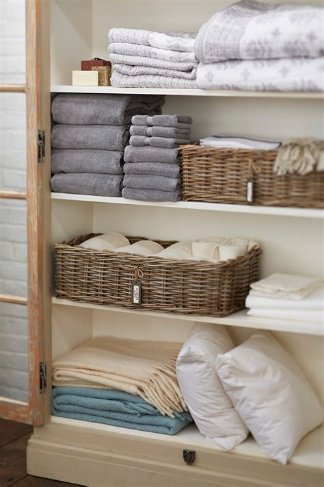 organize towels linen closet how to organize a linen closet how to decorate