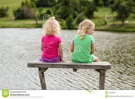 sitting on the bench children sitting on the bench royalty free stock image