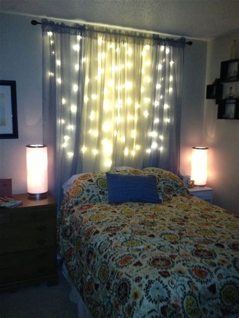 blue bedroom lights christmas lights and sheer curtains as a light headboard
