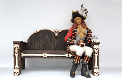 sit on a bench female pirate sitting on bench life size statue
