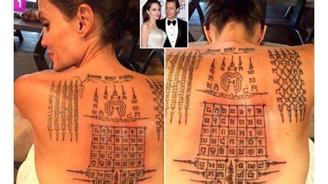 angelina jolie tattoo in thai thai monk gives angelina jolie painful tattoos binding