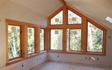 wood trim molding around row of windows october 26 here s the window trim finished in rick s