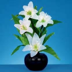 fibre optic white lillies 50cm table l