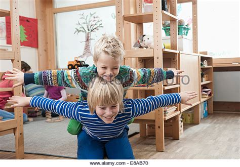two brothers bring their families together to share a scenic getaway dwell piggy back child toddler stock photos piggy back child