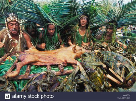 local polynesians in fatu hiva roast a pig in the