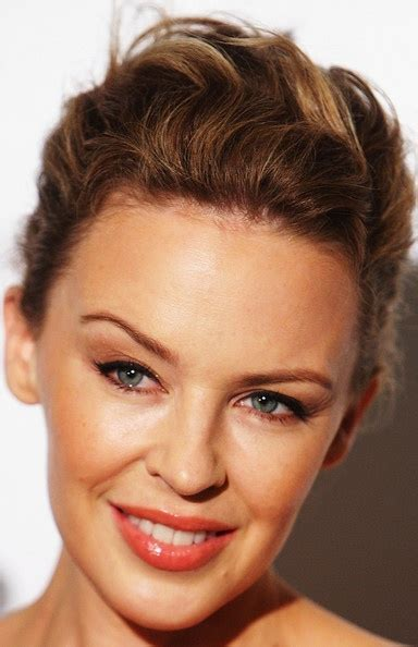 casual chignon updo hairstyle for women kylie minogue hairstyle 244 best images about kylie australian diva on pinterest