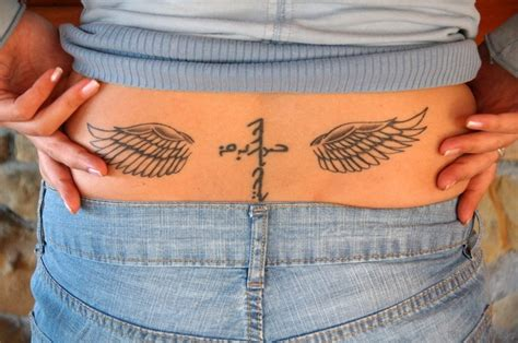 lower back wing tattoo designs 98 best cross with wings tattoos for back