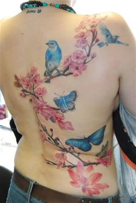 tattoo flower branch bird women tattoo ideas and bird women tattoo designs