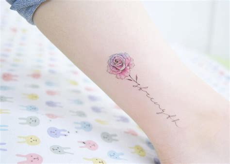 rose script tattoo garnet and alexandrite flowers with the boys names as the
