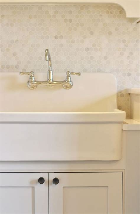 sink backsplash farmhouse sinks laundry rooms and white shaker cabinets