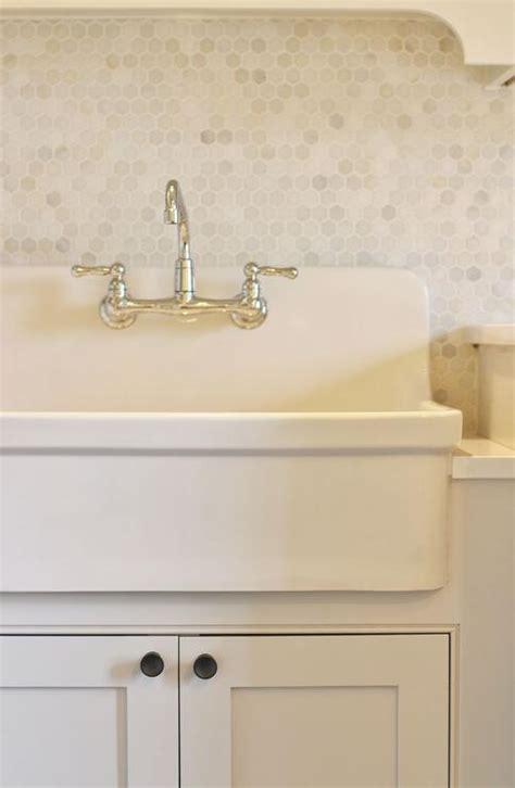apron sink with backsplash laundry room with marble hex tile backsplash transitional laundry room