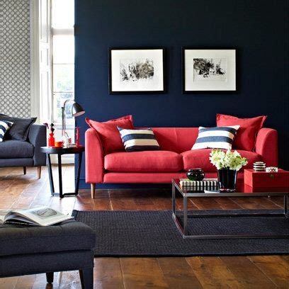 red couch wall color rich blue walls and red sofa with dark wood floors for