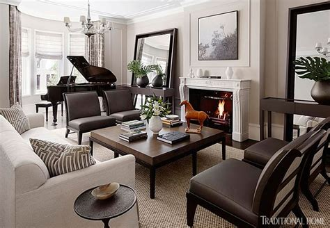 living room with piano a floating arrangement of matching leather chairs and a