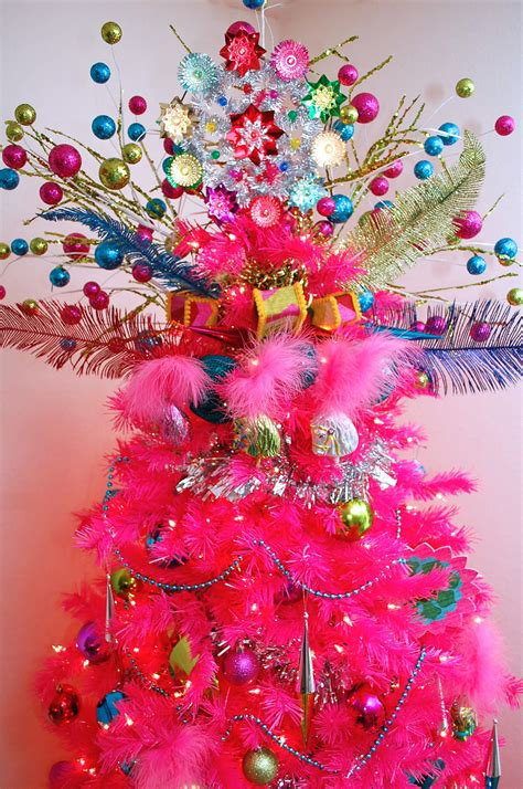 hot pink christmas tree with colorful tree topper pictures