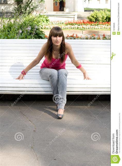 girl sitting on bench girl sitting on bench royalty free stock photo image
