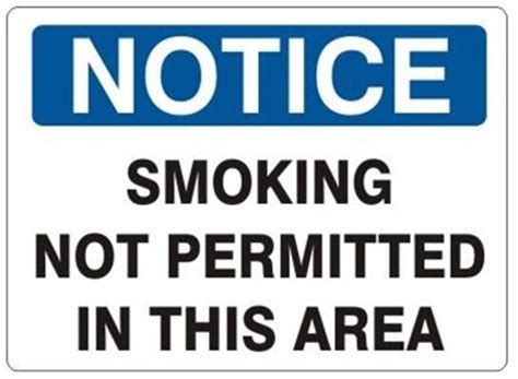 notice not permitted in this area sign