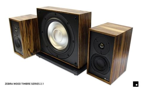 a handcrafted custom zebra wood speaker system including a