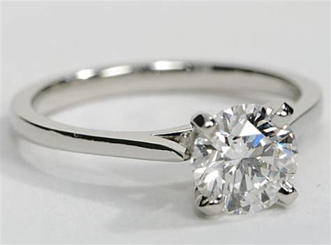 thin band cathedral solitaire engagement ring in