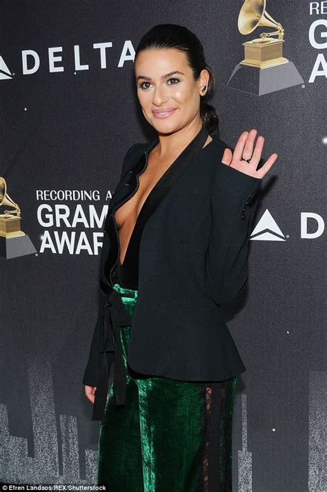 Lea Tops braless lea michele wears revealing top at delta