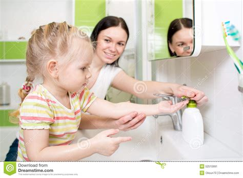 mom and son in bathroom happy kid with mom washing hands in bathroom stock photo