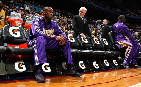 kobe bryant bench kobe bryant sits on the bench before he is introduced in